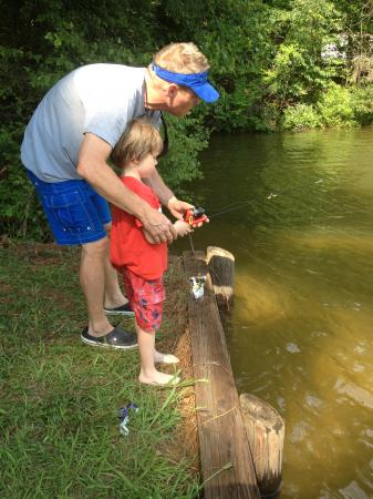 Julia Sims' husband teaches their son to fish.