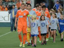 Carolina RailHawks with youth soccer players