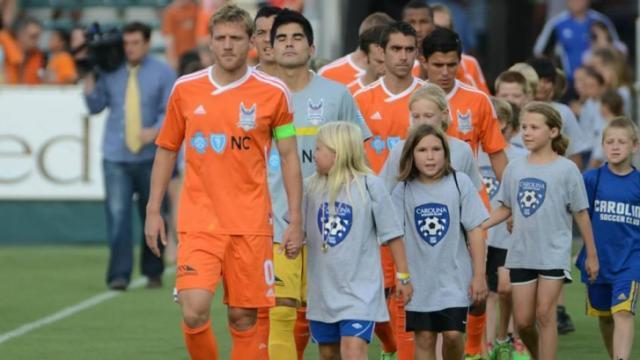 Carolina RailHawks with youth soccer players. Courtesy: Carolina RailHawks