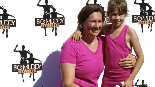 Stacy Lamb and her daughter pose after the Big Muddy Challenge