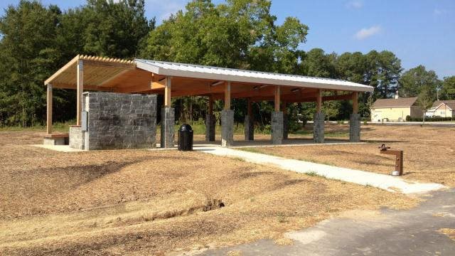 A picnic shelter sits near the playground.