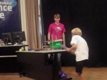 Quin Walker leads an experiment during a Science Live! presentation.
