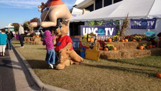Read-a-roo meets and greets at the Marbles and UNC-TV tent at the fair.