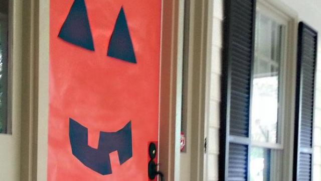 Easy Halloween door decoration. Courtesy: All Wrapped Up