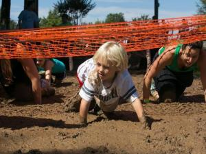 Kids and parents participate in the Big Muddy Challenge in September 2013 at Hill Ridge Farms in Youngsville.