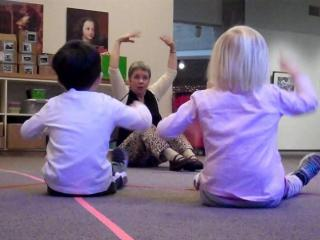 Jody Cassell leads children in a What's in the Box program at the N.C. Museum of Art