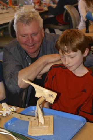 Artist Steve Gerberich, whose exhibit at the Museum of Life and Science closed last weekend, helps kids with their own creations.