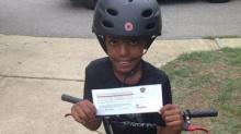 Asher Devenouges with his ticket for safe bike riding from the Apex Police Department