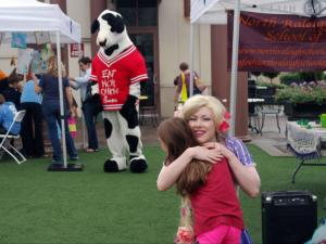 Rapunzel shared hugs and posed for photos at the Go Ask Mom playdate Sept. 13, 2014, at the Midtown Farmers' Market.