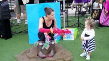 "Kristin Schmalzbauer performs ""The Hand Fish"" at Midtown Farmers' Market"