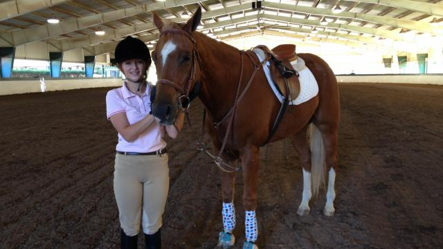 Mikayla Spell with her horse at the Hunt Horse Complex in Raleigh.
