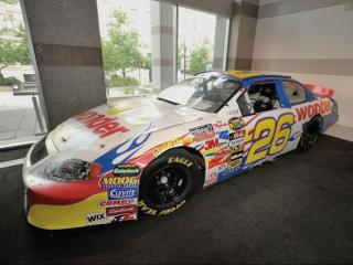 "Ricky Bobby's No. 26 Wonder Bread race car from the 2006 movie ""Talladega Nights: The Ballad of Ricky Bobby."" The 2006 Chevrolet, currently on view in the museum lobby, is on loan from International Motorsports Hall of Fame in Talladega, Ala., and from Shell Oil. Image Credit: N.C. Museum of History"