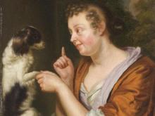 Godfried Schalcken, A Young Lady Playing with a Dog, circa 1690s, oil on panel, 7 3/4 x 6 1/4 in., Private Collection