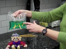 Beth Harris, a long-time science educator, demonstrates an easy experiment