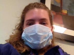 Sarah Lindenfeld Hall, Go Ask Mom editor, dons a mask to protect other patients from the flu at the doctor's office.