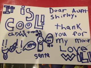 Julia Sims' son pens thank you notes for his Christmas presents.