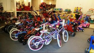 Bikes wait for buyers at Kids Everywear Consignment Sale
