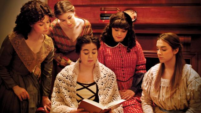 Little Women production photo shows (from left to right) Meredith students Maigan Kennedy as Jo, Lauren Knott as Meg, Elaina Mittleman as Amy, Sydney Ferrell (on floor) as Beth and Karyn Raynor (seated) as Marmee.
