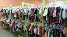 Clothes fill racks at JoCo Kids Consignment Sale in 2013