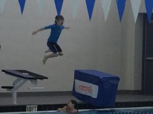 A few cannonballs helps Julia Sims' son muster the courage to tread water.