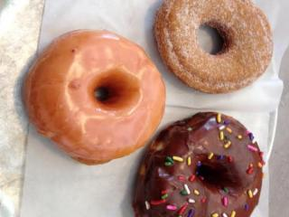 A strawberry lemonade, chocolate sprinkles and apple cider doughnut from Monuts Donuts.