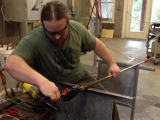 Glass artist Harrison Harper at work