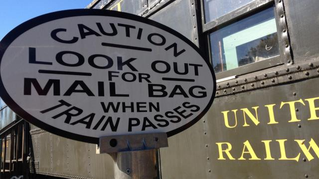 Years ago, the mail was delivered when bags were thrown out of a train.