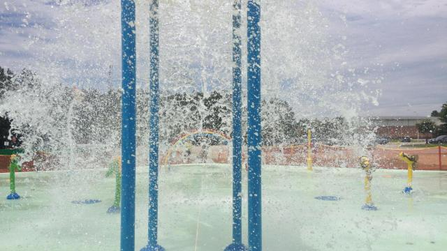 The splash pad at South Park features a variety of jets and pieces that spray or dump water.