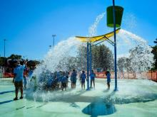 Fuquay-Varina will open its splash pad Wednesday, July 15. The pentagon-shaped sprayground features dozens of jets of streaming water and a variety of pieces that dump or spray water.