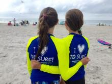 Despite fears of sharks, Amanda Lamb's daughter and niece brave surf camp and have a great time.