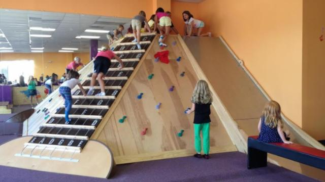 Kids can walk up the guitar fretboard, making sounds along the way, and then slide down.