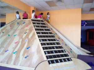 Kids wait to slide.