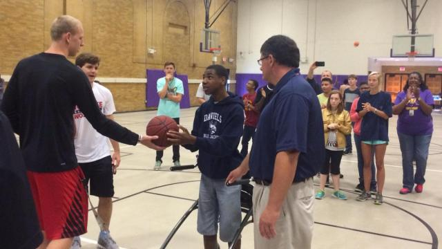 N.C. State basketball players meet with kids with special needs at Broughton High School.