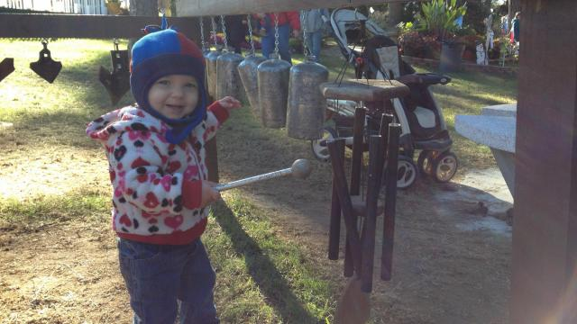 Abagail Wadsworth, 15 months, has a blast at the show's new music garden.