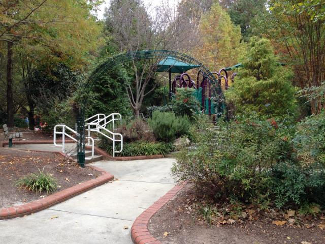 The playground mixes a garden and play structures.