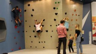Scaling the rock wall at Kidzu Children's Museum