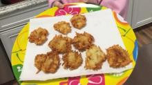 Chef Hannah with homemade latkes