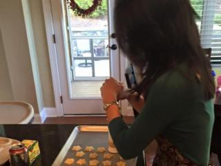 WRAL's Renee Chou uses a cookie press to create spritz cookies.