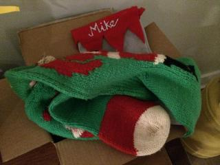 Julia Sims' Christmas stockings sit in a box.
