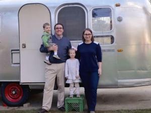Kelley family next to their Airstream.