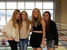 Young singers Caroline Dare (left) of Greenville, Brooke Hatala of Cary and Kaylin Roberson (far right) of Raleigh stand with Kayla Lynn of West Virginia, whose mother created the national One Voice Project