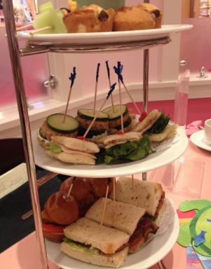 Tea includes a selection of small sandwiches and muffins.