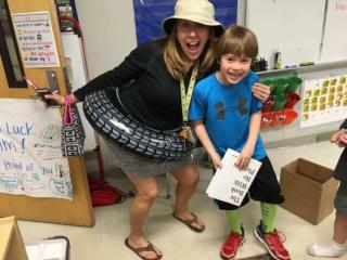 Julia Sims' son Will with his second grade teacher