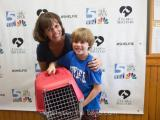 Julia Sims with her son and their new cat