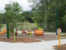 The park at 4420 Louis Stephens Rd. he includes a playground, basketball court, terraced lawn, preserved forest, pedestrian trail, pickleball courts, a picnic shelter and a central pond with an earthen dam.