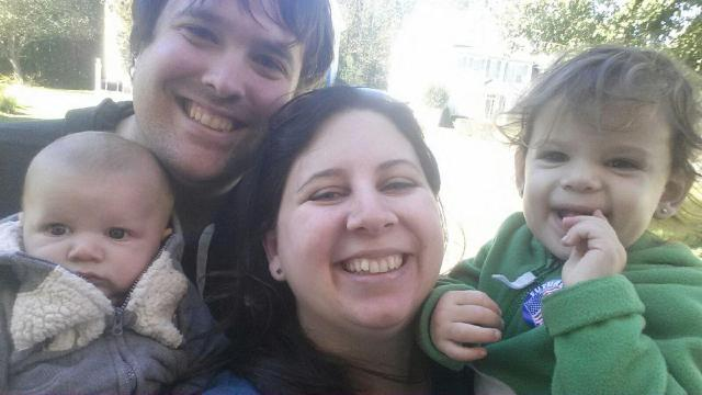 MomsRising member Kim Swanson voting with her husband and kids in Durham.