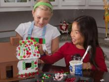 The reusable gingerbread house is made by The Candy Cottage, based on Rocky Mount.
