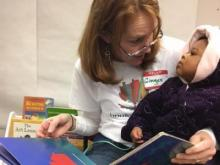 Ginger Young reads to a young child