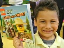 The Durham-based group collects books and distributes them to kids in the Triangle.