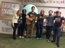 Robin Curtis (second from left) is opening up a Raleigh location for Songs for Seeds, a music program for children. She's pictured with her band and the program's founders.